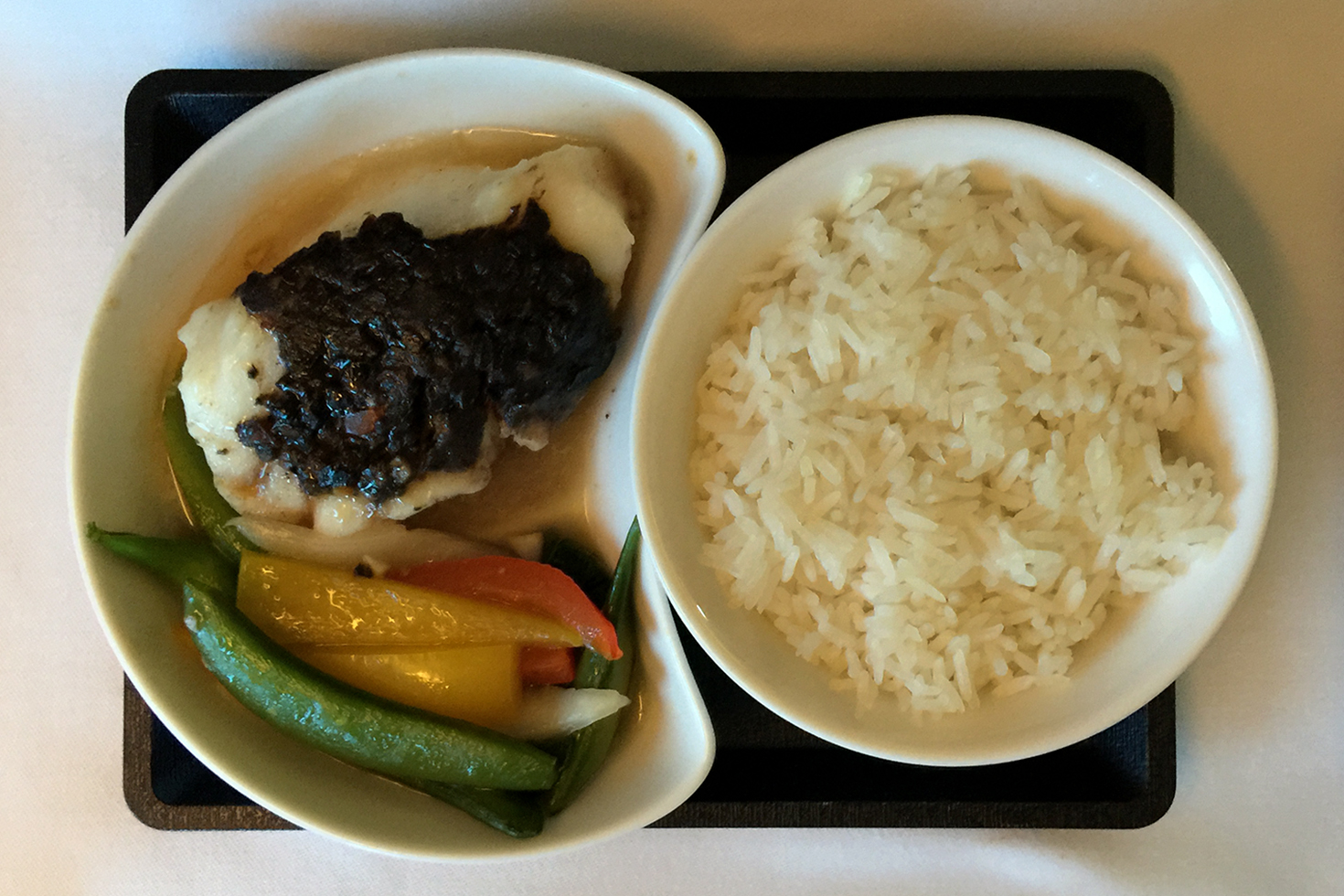 Sea bass with olive tapenade on Cathay Flight 831 | In the air