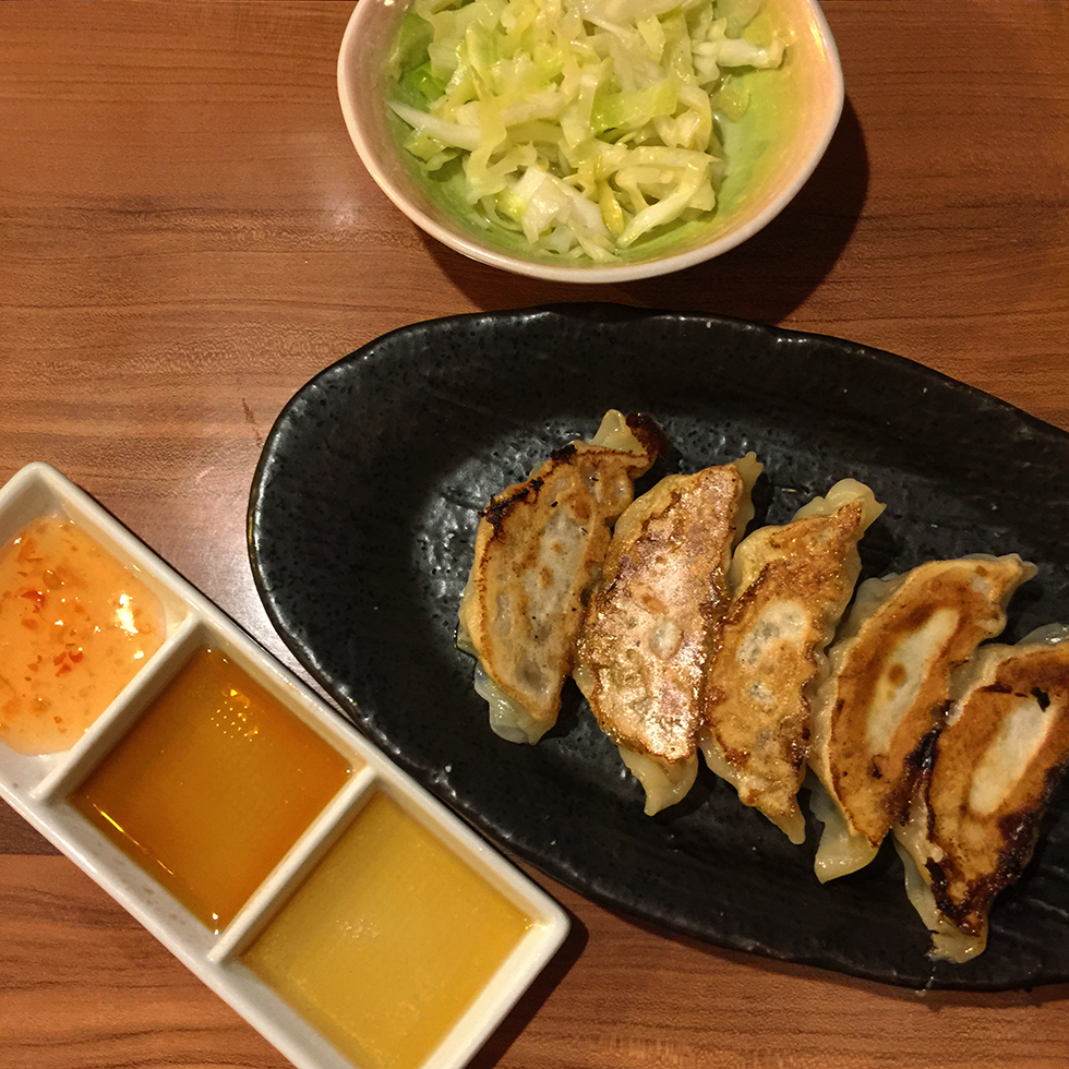 Pork gyoza and cabbage slaw to accompany my ramen | Kyoto, Japan